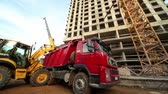 cabine : MOSCOW - SEPTEMBER 27: Excavator loads truck at construction site of living house, September 27, 2010 in Moscow, Russia. In 2010, in Moscow there were more than 215 million square feet of living space
