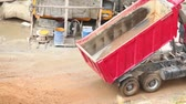 cabine : Dump truck unloads sand and went on, at sunny summer day on building place