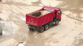 cabine : Empty tipper truck leaving from construction site