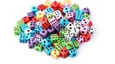 opportunities : many colorful dice stacked in pile rotate on white background