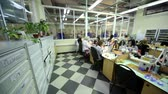 şantiye : MOSCOW - FEBRUARY 16: Few women work at tables in workplace at Estet Jewelry House manufacturing, February 16, 2011, Moscow, Russia. In 2009, Estet Jewelry House moved into its own spacious building Stok Video