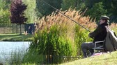 paisagem : Most, Czech Republic - May 11, 2014: Fishing man on pond Benedikt
