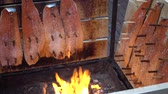 cedro : Salmon is smoked on open fire at Christmas market in Hannover. Germany.