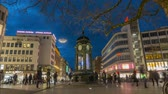 alan : Hannover, Germany - January 10, 2018: The historic Kroepcke clock is a popular meeting place located on the central Kroepcke square in downtown Hannover. Time lapse. 4K