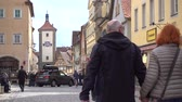 bavyera : Rothenburg ob der Tauber, Germany - March 31, 2018: Street view of Rothenburg ob der Tauber, a well-preserved medieval old town in Middle Franconia in Bavaria on popular Romantic Road through southern Germany.