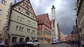 kareler : Rothenburg ob der Tauber, Germany - March 31, 2018: Street view of Rothenburg ob der Tauber, a well-preserved medieval old town in Middle Franconia in Bavaria on popular Romantic Road through southern Germany.