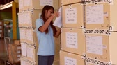 box : female worker checking finished goods carton in warehouse. Stock Footage