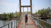 эстакада : Woman walking on suspension bridge in Mangrove forest, Thailand