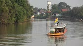 empty barge : A small tugboat pulls cargo boat in Thailand