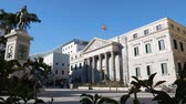 Congress of Deputies. The Palace of the Spanish Courts, Spain? S parliament, in the Plaza de las Cortes and the Statue of Miguel de Cervantes