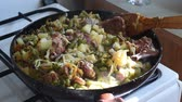 braised dishes : Cooking vegetables in a pan cabbage with meat Stock Footage