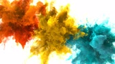 csík : Orange Yellow Cyan Color Burst - Multiple colorful smoke powder explosion fluid ink particles slow motion alpha matte isolated on white Stock mozgókép