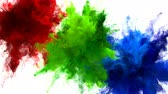 holi : Red Green Blue Color Burst - Multiple colorful smoke powder explosion fluid ink particles slow motion alpha matte isolated on white