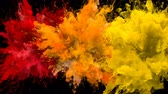 Red, Orange, Yellow Color Burst - Multiple colorful smoke powder explosion fluid ink particles slow motion alpha matte isolated on black Stock Footage