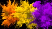 Orange, Yellow, Purple Color Burst - Multiple colorful smoke powder explosion fluid ink particles slow motion alpha matte isolated on black