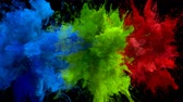 Blue, Green, Red Color Burst - Multiple colorful smoke powder explosion fluid ink particles slow motion alpha matte isolated on black