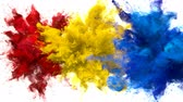 Red, Yellow, Blue Color Burst - Multiple colorful smoke powder explosion fluid ink particles slow motion alpha matte isolated on white Stock Footage