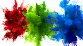 Red, Green, Blue Color Burst - Multiple colorful smoke powder explosion fluid ink particles slow motion alpha matte isolated on white Stock Footage