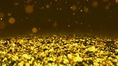 Golden Shiny glitter background abstract texture close up macro seamless loop particles