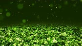 Green Shiny glitter background abstract texture close up macro seamless loop particles Stock Footage