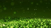 dof : Green Shiny glitter background abstract texture close up macro seamless loop particles Stock Footage