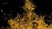 Abstract Golden glitter explosion in slow motion Bokeh background with shining defocus blurred sparkles dust macro close up with alpha channel