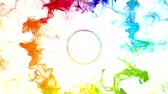 Multiple iridescent multicolored rainbow particle paint vivid colored powder smoke pulsating shockwave circle explosions logo copy space copyspace top view animation alpha 4k VJ loop isolated on white