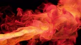 Orange red color paint ink drops in water slow motion art background with copy space. Inky cloud swirling flowing underwater. Abstract smoke fluid  liquid animation isolated on black alpha channel