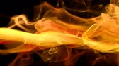 Yellow orange color paint ink drops in water slow motion art background with copy space. Inky cloud swirling flowing underwater. Abstract smoke fluid  liquid animation isolated on black alpha channel