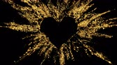 Golden shining glitter burst explosion forming a heart shaped hole. St. Valentines Day love animation. Vivid bokeh sparkles, glowing particles. Romantic lovely logo copy space. Alpha copyspace 4k