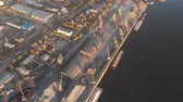кран : Port river cranes loading ships on barges delivery, sunset. Aerial drone Стоковые видеозаписи