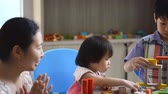 brother : Little asian children playing with colorful construction blocks on table Stock Footage
