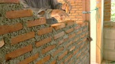 cantaria : Worker build brick wall with trowel at construction site