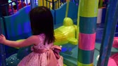 Little asian girl on the indoor playground