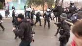 полиция : Riot officer uses baton to push away protesters - HD 1080p - Riot police officers in low numbers are taken over and clash and battle with protesters with mounted police.