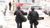 koruyucu : 2 members of a high risk paramedic team are walking down a hill front and back view Stok Video
