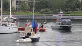 rescue : Police and fire boat meeting with sailboat Marine police officers and coast guard members arriving on scene near a sailboat and talking with boat occupant while others are watching at sea. Stock Footage
