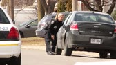 крейсер : Blond officer with gun drawn peaking at camera White blond young looking female police officer hiding behind a car with gun drawn looking at the camera under the sun.