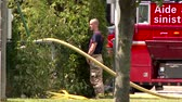peeing : Fireman urinating at scene of house fire Bold fire fighter male is urinating near bush with firetruck and water hose