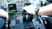 кокпит : Commercial airplane pilots hand pushing thrust during take off  - Commercial license no logo no face