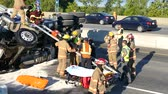 4K UHD - Truck driver rescued from rolled over truck with fireman ladder