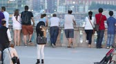 4K UHD - Young couple taking a walk at observation platform with tourists Stok Video