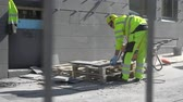 Worker sawing stones for road construction at the street Stock Footage