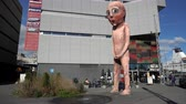 Statue of naked peeing boy near ferry