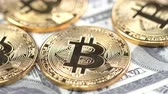 vez : Bitcoins on dollar banknotes background, closeup