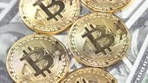 sanal : Bitcoins on dollar banknotes background, closeup