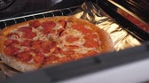 fast food : Close oven with cooking pizza at home Stock Footage