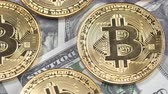 Банкнота : Bitcoins on dollar banknotes background, closeup