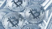 Rotating bitcoins on dollar banknotes background Wideo