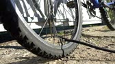 Pumping up bicycle wheel outdoor Stock Footage